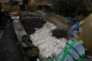 Bathroom debris being covered with pond filter stones
