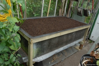 Tank filled with compost